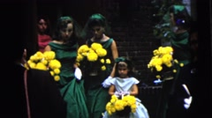 1962: bridesmaids and a flower girl walk outdoor while holding flowers. BOSTON Stock Footage