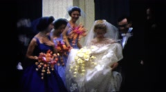 1962: a bride and groom leaving their wedding overjoyed. BOSTON Stock Footage