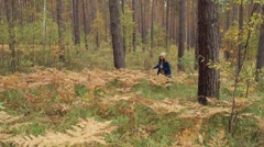 Happy girl run in autumn forest Stock Footage