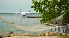 Hammock by sea and closeup view of sea plane 2 Stock Footage