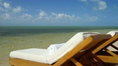 Relaxing scene on beach with view of tropical ocean 3 Stock Footage