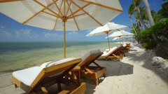 Relaxing scene on beach with view of tropical ocean Stock Footage