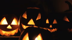 Glowing scary pumpkins at night on the steps Stock Footage