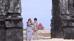 Two young pretty sexy ladies taking a selfie together near the balinese temple Stock Footage