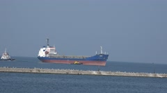 Posting tugs big dry cargo ship in port of loading to pier Stock Footage
