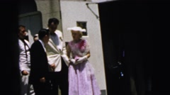 1964: young couple in formal wear receiving instructions from a man CAMDEN Stock Footage