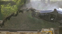 Slow motion milled asphalt cold milling machine pour in the truck Stock Footage