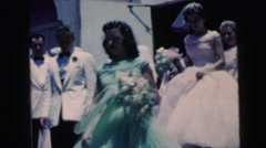 1964: wedding party leaving church in formal dress CAMDEN, NEW JERSEY Stock Footage