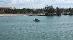 MIAMI,FLORIDA,USA-.Miami Dade Police boat patrolling the Miami Port area Stock Footage