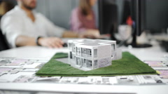Businessman signs contract behind home architectural model. Close up. 4k Stock Footage