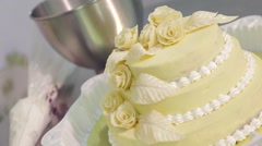Pastry chef decorates a cake Stock Footage