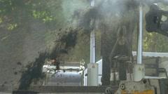 Cold milling machine grinds asphalt, slow motion Stock Footage