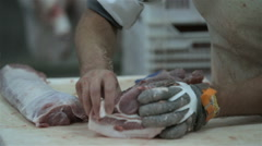 Butcher Cutting Pork Meat in Meat Factory. Fresh raw pork chops in meat factory. Stock Footage