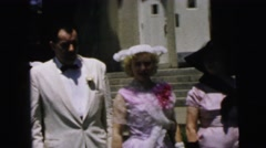 1964: men and ladies dressed in formal fifties attire stand outdoor Stock Footage
