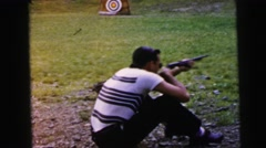 1964: two men at target practice CAMDEN, NEW JERSEY Stock Footage