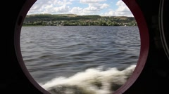 River landscape in the porthole of the ship Stock Footage