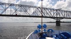 The ship passes under the bridge Stock Footage