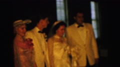 1964: members of wedding party pose during celebration CAMDEN, NEW JERSEY Stock Footage