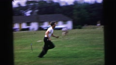 1964: playing man runs ball catch open field CAMDEN, NEW JERSEY Stock Footage