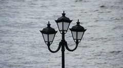 Street lamp on a background of water Stock Footage