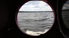 Water and shore aboard a river boat Stock Footage
