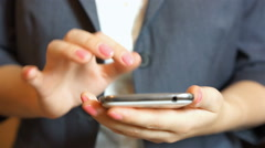 Businesswoman typing on smartphone screen, mobile app, shopping, browsing web Stock Footage