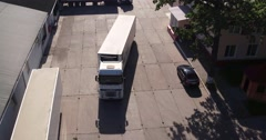Aerial view of Trucks which leaves the meat factory Stock Footage