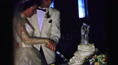 1964: just married couple is cutting their wedding cake CAMDEN, NEW JERSEY Stock Footage