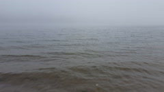 Early morning scene at quiet river with mist. Stock Footage