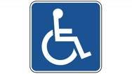 Footage of a person in a wheelchair traffic sign, the shot is coming into focus Stock Footage