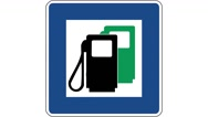Footage of a gas station traffic sign, the shot is coming into focus Stock Footage