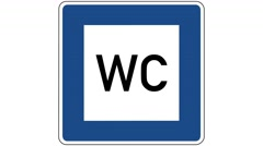 Footage of a restroom traffic sign, the shot is coming into focus Stock Footage