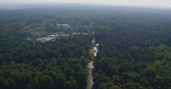 Aerial view of the road through green forest. Meat factory Stock Footage