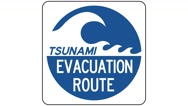 Footage of a tsunami evacuation route sign, the shot is coming into focus Stock Footage