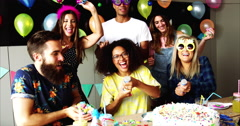 Festive partygoers surrounded by confetti Stock Footage