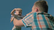 Cheerful father throwing his son in the air several times Stock Footage
