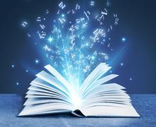 Blue magical book Stock Photos