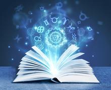Astrology magic book Stock Photos