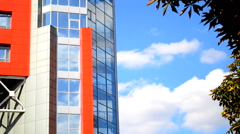HD 1080 modernistic facade of the building in the style hi-tech and white clouds Stock Footage