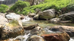 Crystal Clear Water Cascade on Rocks in Wales Stock Footage