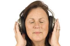 Mature Woman Listening To Music Kuvituskuvat