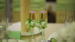 Two glasses of champagne at the wedding table Stock Footage