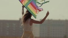 Beautiful fair-skinned young woman rotating holding a kite Stock Footage