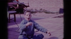 1968: excited boy displaying all the easter eggs he's found CLARKSDALE, ARIZONA Stock Footage