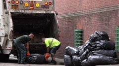 Loading garbage truck with black trash bags in NYC 4k Stock Footage