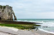 The beach and stone cliffs in Etretat, France Stock Photos