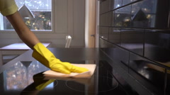 Housewife wipes the electric stove with a cleaning cloth.  Slow motion. Stock Footage