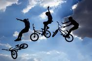 Bike jump silhouettes multiple exposure Stock Photos