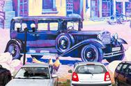 Building wall street art painting old car Stock Photos
