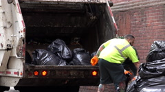 DSNY loading trash bags into garbage truck 4k Stock Footage